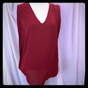 Tunic length dark red sleeveless blouse
